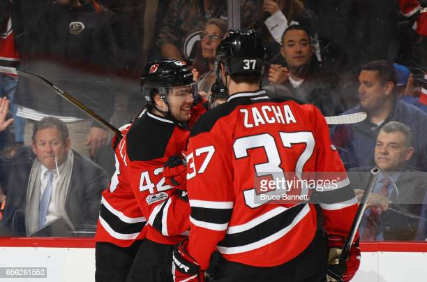 John Quenneville of the New Jersey Devils celebrates his first NHL goal against the New York Rangers on the powerplay at 1516 of the second period at...