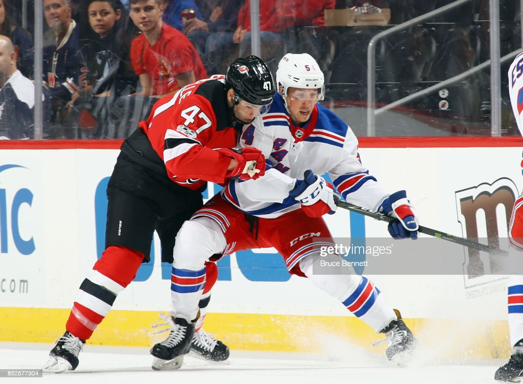 c5dcd1a17 John Quenneville of the New Jersey Devils checks Gabriel Fontaine of ...