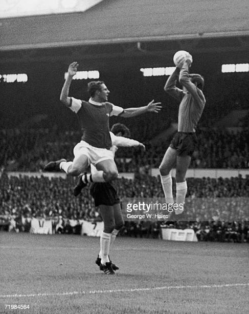 John Radford of Arsenal outjumps Mike England of Tottenham Hotspur during the official opening of the 196869 football season at White Hart Lane but...