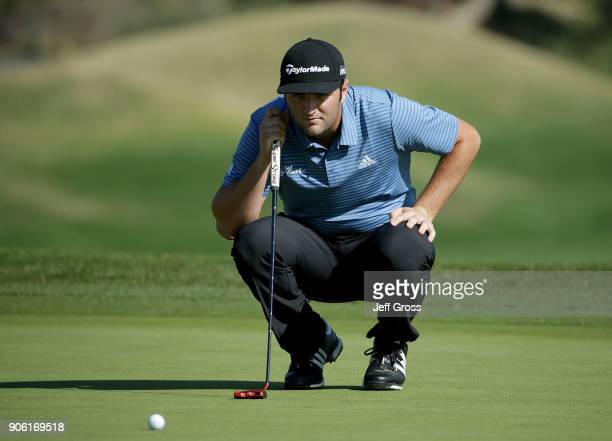 John Rahm of Spain lines up a putt on the 18th green during practice for the CareerBuilder Challenge at the Jack Nicklaus Tournament Course at PGA...