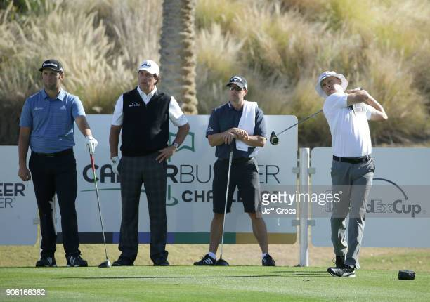 John Rahm of Spain Phil Mickelson and Tim Mickelson watch Ben Crane play his tee shot on the 18th hole during practice for the CareerBuilder...
