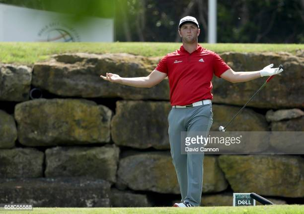 John Rahm of Spain raects to his tee shot on the par 4 fifth hole in his match against Dustin Johnson of the United States during the final of the...