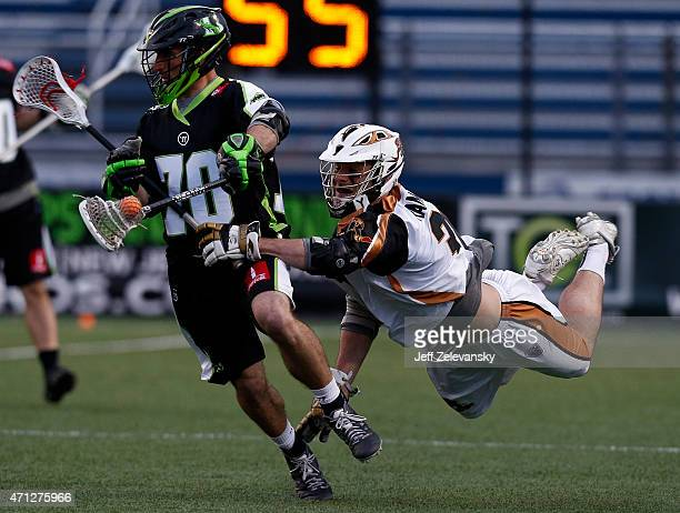John Ranagan of Rochester Rattlers chases Steve DeNapoli of New York Lizards in the second half at James M Shuart Stadium on April 26 2015 in...