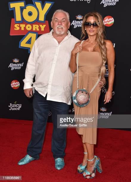 John Ratzenberger and Julie Blichfeldt attend the Premiere of Disney and Pixar's Toy Story 4 on June 11 2019 in Los Angeles California