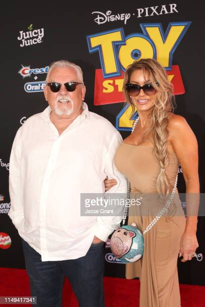 John Ratzenberger and Julie Blichfeldt attend the world premiere of Disney and Pixar's TOY STORY 4 at the El Capitan Theatre in Hollywood CA on...