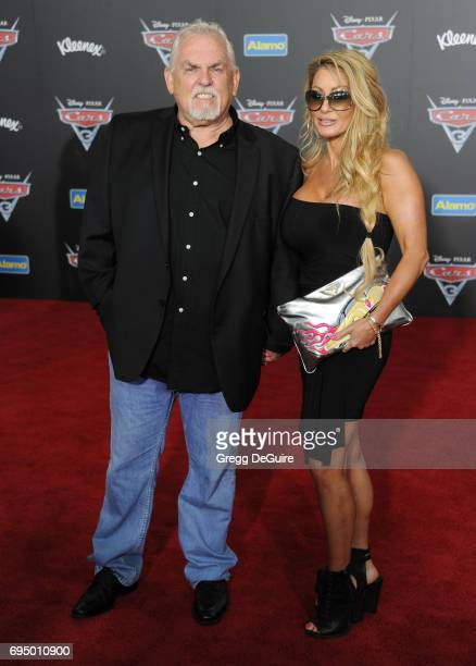 John Ratzenberger and wife Julie Blichfeldt arrive at the premiere of Disney And Pixar's 'Cars 3' at Anaheim Convention Center on June 10 2017 in...