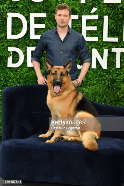 John Reardon and Diesel Vom Burgimwald from the serie Hudson Rex attend the 59th Monte Carlo TV Festival Day Four on June 17 2019 in MonteCarlo Monaco