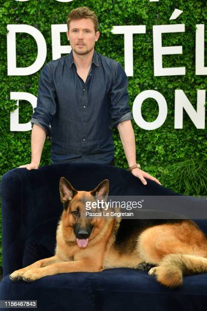 """John Reardon and Diesel Vom Burgimwald from the serie """"Hudson & Rex"""" attend the 59th Monte Carlo TV Festival : Day Four on June 17, 2019 in..."""