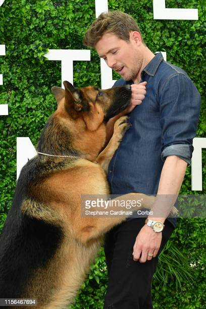 John Reardon and the dog Diesel Vom Burgimwald pose during a photocall for the TV show Hudson and Rex as part of the 59th Monte Carlo TV Festival Day...