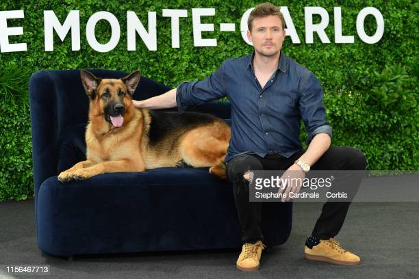 """John Reardon and the dog Diesel Vom Burgimwald pose during a photocall for the TV show """"Hudson and Rex"""" as part of the 59th Monte Carlo TV Festival :..."""