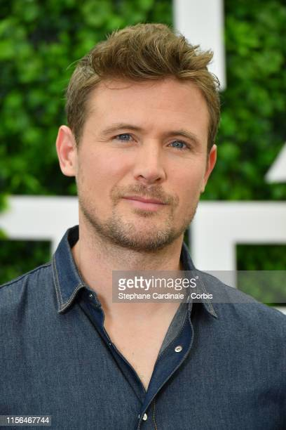 """John Reardon poses during a photocall for the TV show """"Hudson and Rex"""" as part of the 59th Monte Carlo TV Festival : Day Four on June 17, 2019 in..."""