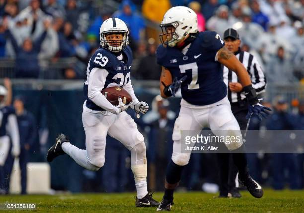 John Reid of the Penn State Nittany Lions returns an interception 44 yards to the 3 yard line in the first half against the Iowa Hawkeyes on October...