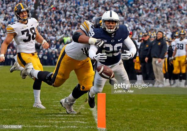 John Reid of the Penn State Nittany Lions returns an interception 44 yards to the 3 yard line against Tristan Wirfs of the Iowa Hawkeyes the first...