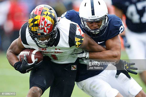 John Reid of the Penn State Nittany Lions tackles DJ Moore of the Maryland Terrapins in the second quarter at Beaver Stadium on October 8 2016 in...