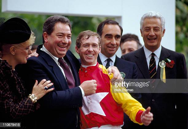 John Reid winner of the Prix de l'Arc de Triomphe at Longchamp on Tony Bin and the husband of the horse's owner Luciano Gaucci celebrate their...