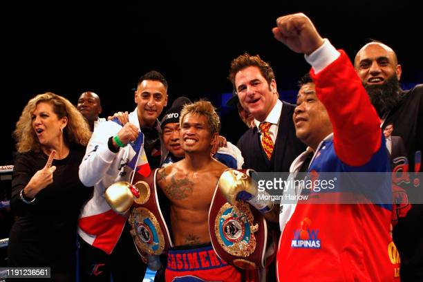 John Reil Casimero celebrates with his teammates after becoming the new champion and winning The WBO World Bantamweight Championship between Zolani...