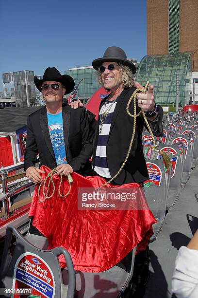 John Rich and Big Kenny unveil their seats aboard the Ride of Fame at Pier 78 on September 26 2014 in New York City
