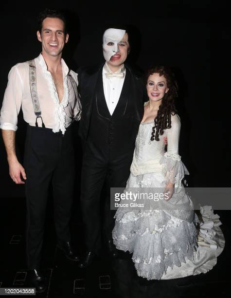 John Riddle as Raoul Vicomte de Chagny Ben Crawford as the Phantom and Meghan Picerno as Christine Daae pose backstage at the 32nd Anniversary...