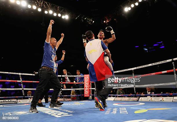John Riel Casimero celebrates victory over Charlie Edwards in the tenth round of their IBF Flyweight Title contest at The O2 Arena on September 10,...