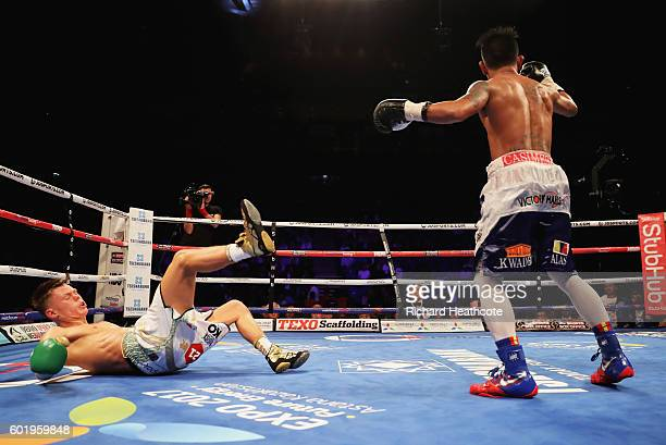 John Riel Casimero knocks down Charlie Edwards in the tenth round of their IBF Flyweight Title contest at The O2 Arena on September 10, 2016 in...