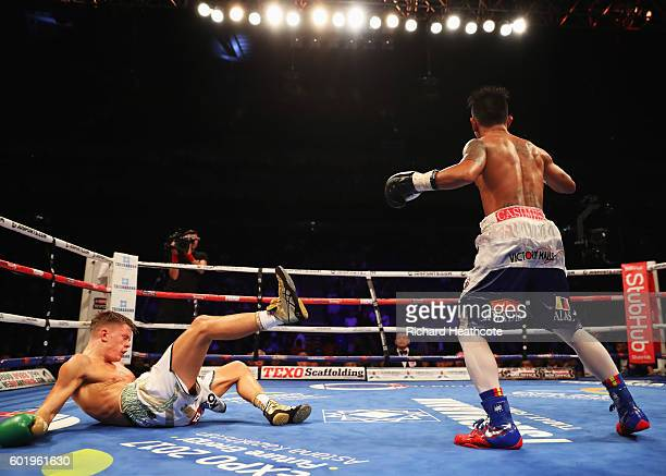 John Riel Casimero knocks down Charlie Edwards in the tenth round of their IBF Flyweight Title contest at The O2 Arena on September 10 2016 in London...