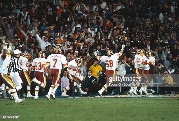 John Riggins and George Starke of the Washington Redskins celebrates after Riggins scored a touchdown against the Miami Dolphins during Super Bowl...