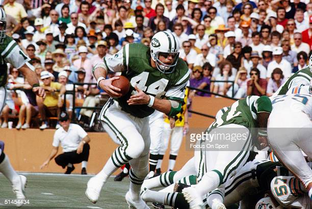 John Riggins of the New York Jets runs against the Miami Dolphins at the Orange Bowl on November 1971 in Miami Florida