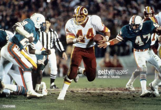 John Riggins of the Washington Redskins carries the ball during Super Bowl XVII against the Miami Dolphins on January 30 l983 in Pasadena California...