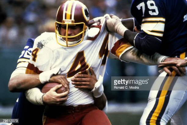 John Riggins of the Washington Redskins carries the ball during the NFL Playoff Game against the Minnesota Vikings on January 151984 in Washington...