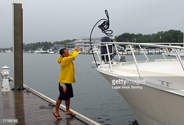 John Riggs helps a boat owner move to safer harbor in preperation for approaching Tropical Storm Ernesto August 31 in Wrightsville Beach North...