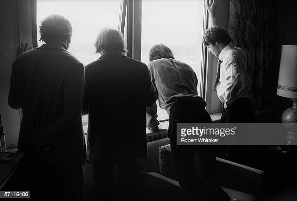 John Ringo George and Paul admire the Tokyo skyline from their presidential suite at the Tokyo Hilton during the Beatles' Asian tour June 1966