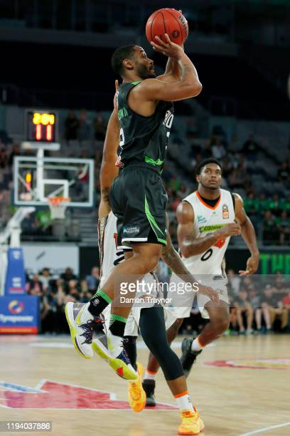 John Roberson of the Phoenix shoots a three pointer during the round 11 NBL match between the South East Melbourne Phoenix and the Cairns Taipans at...