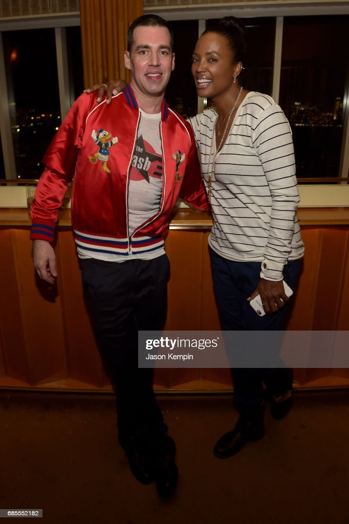 John Roberts and Aisha Tyler attend the Vulture Festival Opening Night Party Presented By AT&T at the Top of The Standard Hotel on May 19, 2017 in New York City.