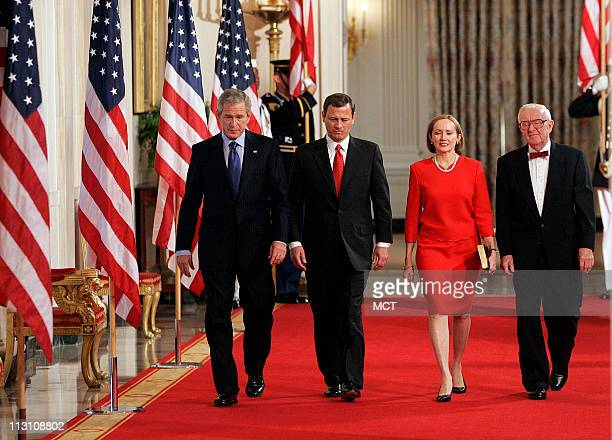 John Roberts, and his wife Jane walk to the East Room with President Bush, left, and Justice John Paul Stevens, right, Thursday, Sept. 29 for the...
