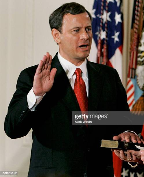 John Roberts is sworn in as Chief Justice of the United States Supreme Court during a ceremony in the East Room at the White House September 29, 2005...