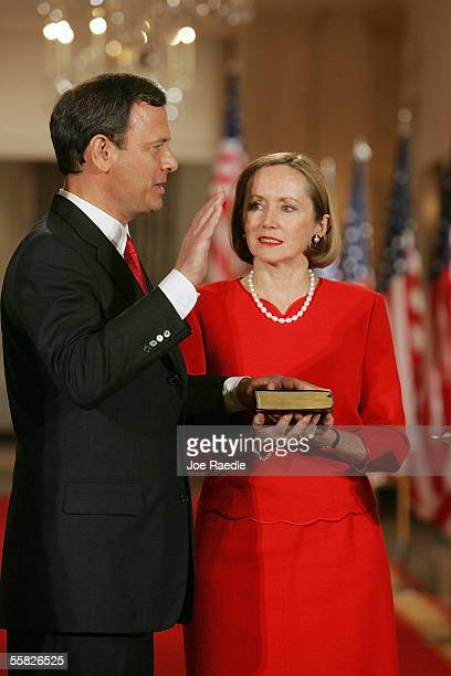 John Roberts is sworn in as Chief Justice of the U.S. By Associate Justice John Paul Stevens as his wife, Jane Roberts, holds a bible during a...