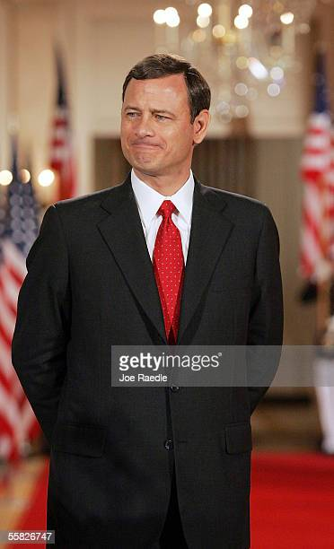 John Roberts listens as U.S. President George W. Bush introduces him as the new Chief Justice of the U.S. During a swearing in ceremony in the East...