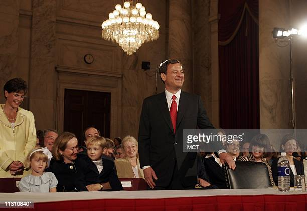 WASHINGTON DC John Roberts nominee for Chief Justice of the United States right is backed by his family seated from left daughter Josie wife Jane and...
