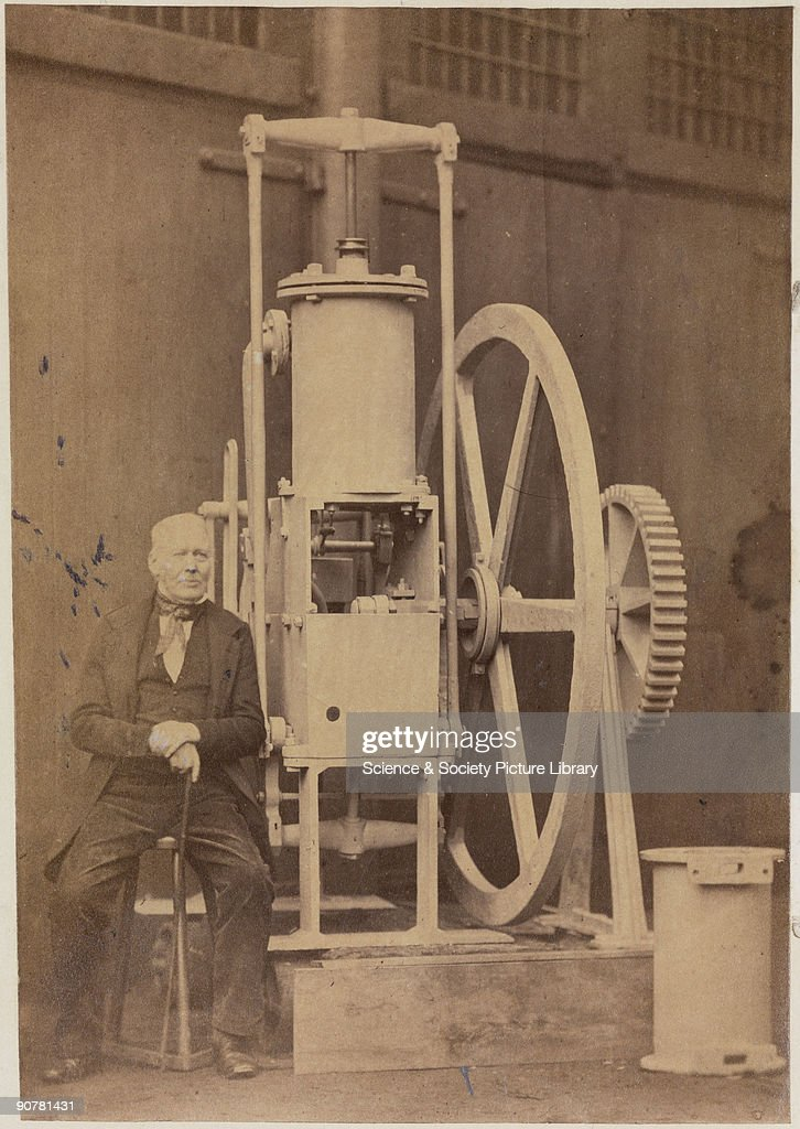 John Robertson in front of the �Comet� engine. John Robertson (1782-1868) was commissioned in 1811 by the Hotelier Henry Bell to build a 13 m (43 ft) boat with a high-pressure steam-engine, designed to bring visitors from Glasgow to his Helensburgh hotel. Though lengthened and fitted with a larger cylinder for the service between Glasgow and Fort William, the �Comet� was underpowered for coastal work and was wrecked in 1820. After serious fire damage, the engine was restored by John Napier & Co in 1855.
