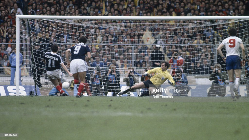 John Robertson (11) of Scotland scores a penalty after sending England goalkeeper Joe Corrigan the wrong way during the England v Scotland British Championship match played at Wembley Stadium, London, England on the 23rd May 1981. Scotland won 1-0.