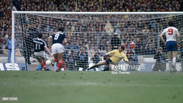 John Robertson of Scotland scores a penalty after sending England goalkeeper Joe Corrigan the wrong way during the England v Scotland British...