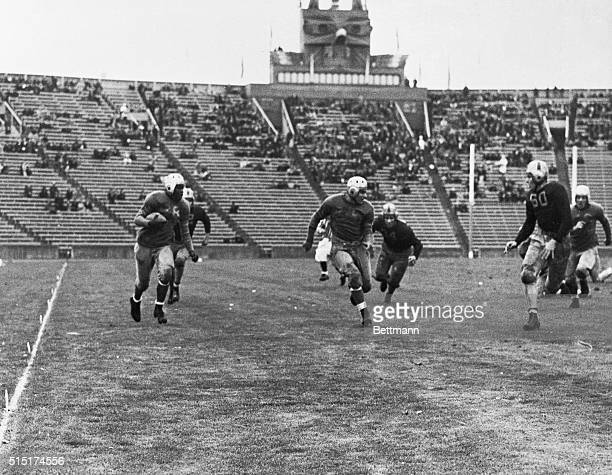 John Robinson UCLA's brilliant sophomore halfback is seen here reeling off a 63yard punt return during the game in which the Bruins defeated the...