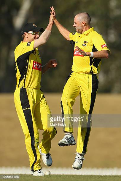 John Rogers and Nathan Rimmington of the Warriors celebrate after Rimmington ran out Aiden Blizzard of the Tigers during the Ryobi Cup match between...