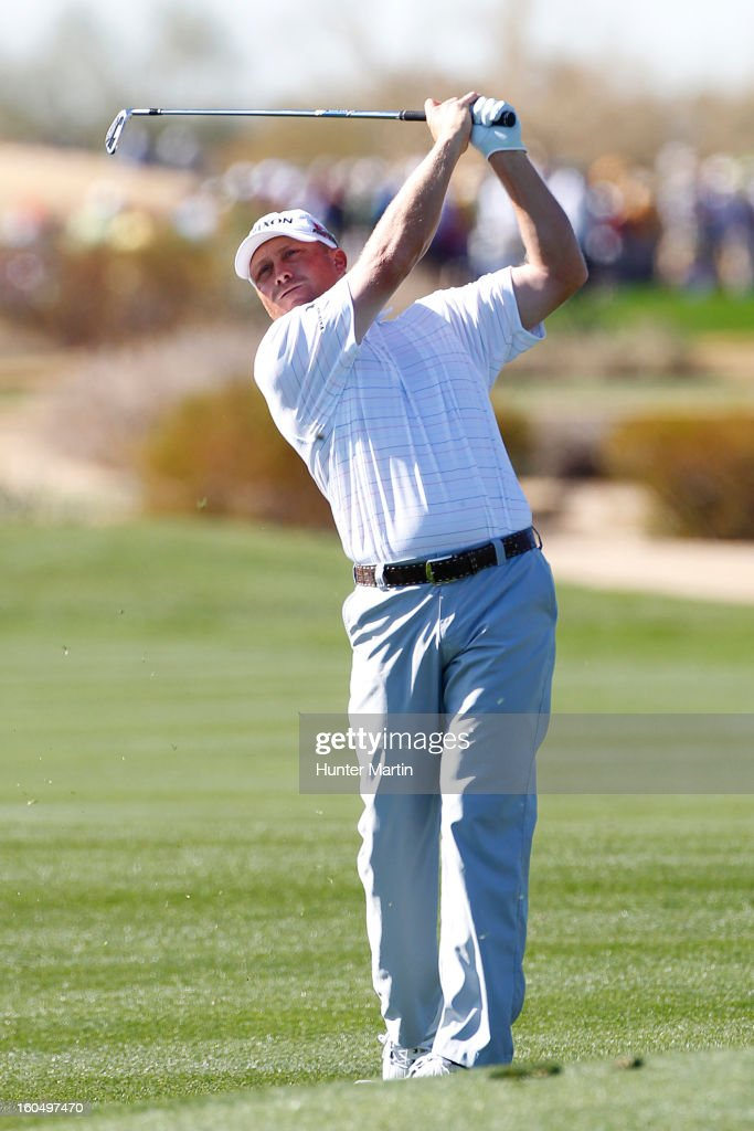 John Rollins hits his second shot on the ninth hole during the second round of the Waste Management Phoenix Open at TPC Scottsdale on February 1, 2013 in Scottsdale, Arizona.