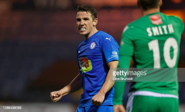 John Rooney of Stockport County celebrates following their sides victory in the Emirates FA Cup Second Round match between Stockport County and...