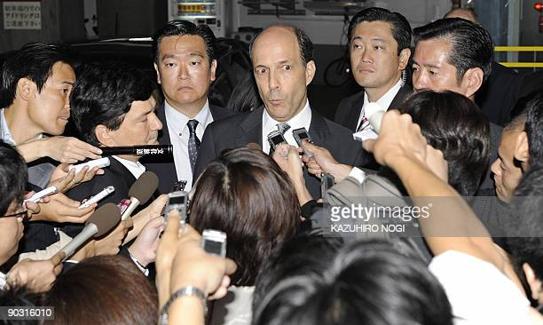John Roos, the new US ambassador to Japan, is surrounded by reporters as he answers questions after a meeting with Democratic Party of Japan leader...