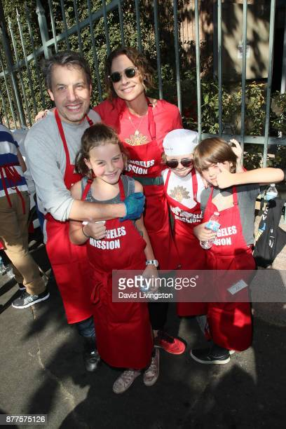 John Ross Bowie Minnie Driver Nola Bowie Henry Driver and Walter Bowie are seen at the Los Angeles Mission Thanksgiving Meal for the homeless at the...