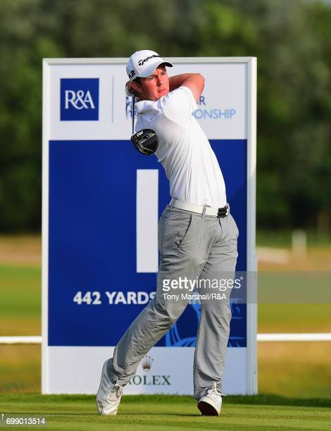 John Ross Galbraith of Whitehead plays his first shot on the first tee during Day 3 of The Amateur Championship at Royal St George on June 21 2017 in...