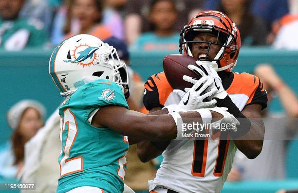 John Ross of the Cincinnati Bengals catches the pass against the Miami Dolphins in the second quarter at Hard Rock Stadium on December 22, 2019 in...