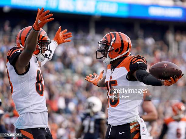 John Ross of the Cincinnati Bengals celebrates his touchdown catch with Tyler Boyd to trail 1412 during the second quarter at StubHub Center on...
